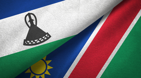 Lesotho and Namibia two flags textile cloth, fabric texture Stock Photo