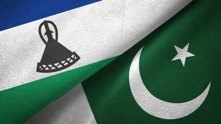 Lesotho and Pakistan two flags textile cloth, fabric texture Stock Photo