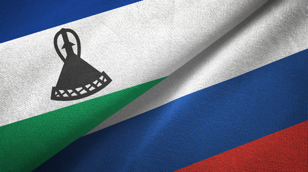 Lesotho and Russia two flags textile cloth, fabric texture Stock Photo