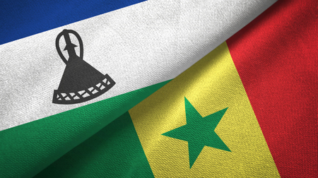 Lesotho and Senegal two flags textile cloth, fabric texture Stock Photo