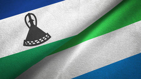 Lesotho and Sierra Leone two flags textile cloth, fabric texture Stock Photo