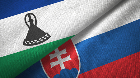 Lesotho and Slovakia two flags textile cloth, fabric texture