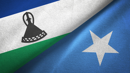 Lesotho and Somalia two flags textile cloth, fabric texture Stock Photo