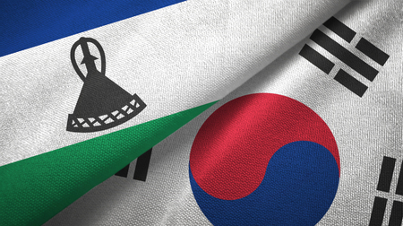 Lesotho and South Korea two flags textile cloth, fabric texture