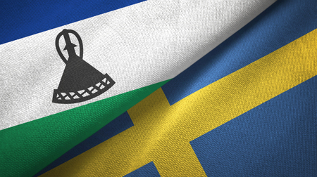 Lesotho and Sweden two flags textile cloth, fabric texture