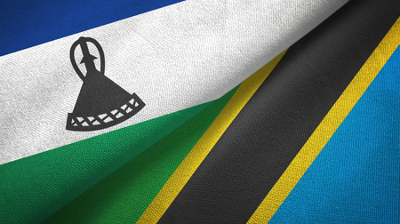 Lesotho and Tanzania two flags textile cloth, fabric texture Stock Photo