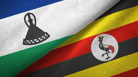 Lesotho and Uganda two flags textile cloth, fabric texture Stock Photo