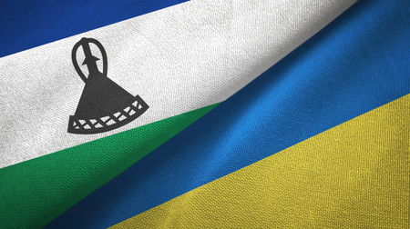 Lesotho and Ukraine two flags textile cloth, fabric texture Stock Photo