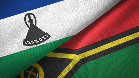 Lesotho and Vanuatu two flags textile cloth, fabric texture Stock Photo