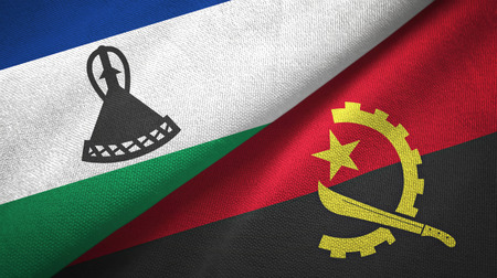 Lesotho and Angola two flags textile cloth, fabric texture Stock Photo