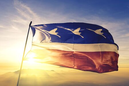 Guaratingueta of Brazil flag textile cloth fabric waving on the top sunrise mist fog