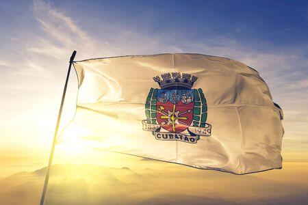 Cubatao of Brazil flag textile cloth fabric waving on the top sunrise mist fog