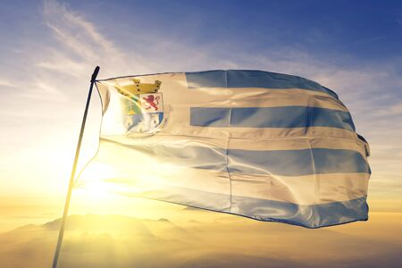 Diadema of Brazil flag textile cloth fabric waving on the top sunrise mist fog