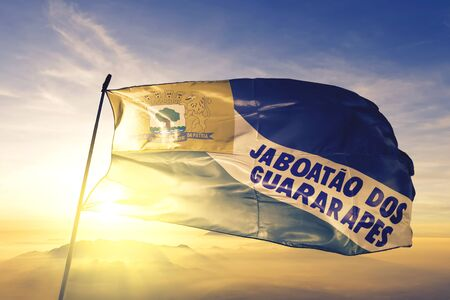 Jaboatao dos Guararapes of Brazil flag textile cloth fabric waving on the top sunrise mist fog Reklamní fotografie
