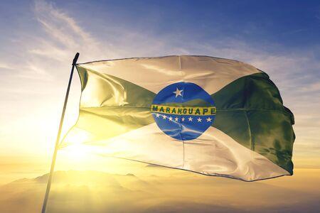 Maranguape of Brazil flag textile cloth fabric waving on the top sunrise mist fog Zdjęcie Seryjne