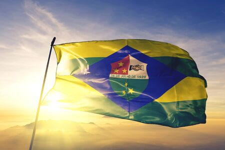 Trindade of Brazil flag textile cloth fabric waving on the top sunrise mist fog Zdjęcie Seryjne - 132758092