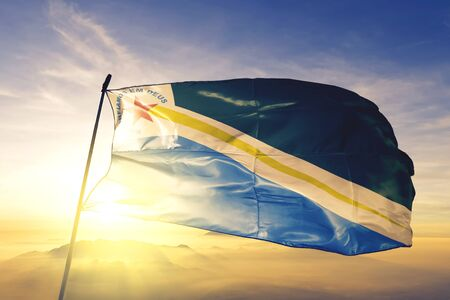 Tucurui of Brazil flag textile cloth fabric waving on the top sunrise mist fog Zdjęcie Seryjne - 132599978