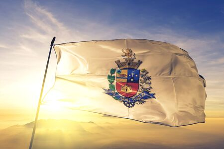 Tatui of Brazil flag textile cloth fabric waving on the top sunrise mist fog Zdjęcie Seryjne