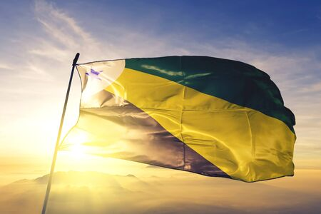 Parauapebas of Brazil flag textile cloth fabric waving on the top sunrise mist fog Zdjęcie Seryjne - 132758112