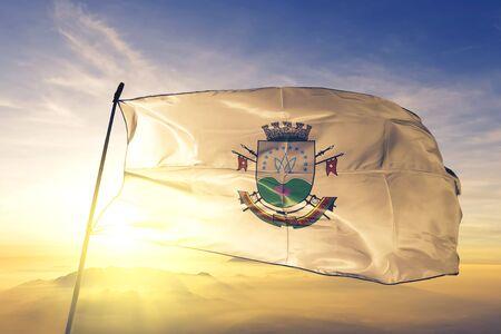 Santa Maria of Brazil flag textile cloth fabric waving on the top sunrise mist fog