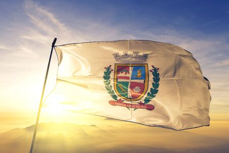 Santa Cruz do Sul of Brazil flag textile cloth fabric waving on the top sunrise mist fog Zdjęcie Seryjne - 132601996