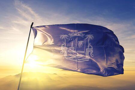 Sao Joao de Meriti of Brazil flag textile cloth fabric waving on the top sunrise mist fog