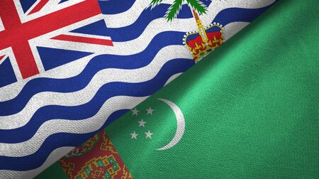 British Indian Territory and Turkmenistan flags together textile cloth Stock Photo