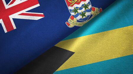 Cayman Islands and Bahamas two folded flags together