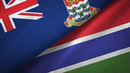 Cayman Islands and Gambia two folded flags together