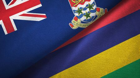 Cayman Islands and Mauritius two folded flags together Stock Photo