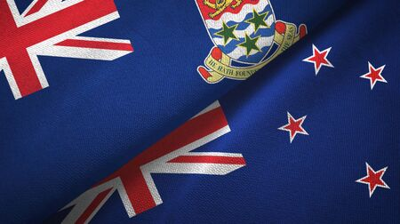 Cayman Islands and New Zealand flags together textile cloth, fabric texture Stock Photo