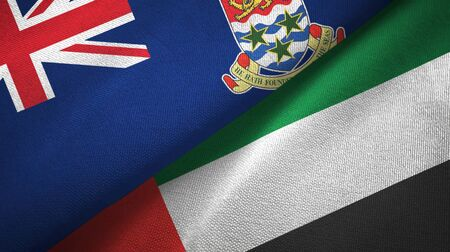 Cayman Islands and United Arab Emirates flags together textile cloth, fabric texture Banco de Imagens
