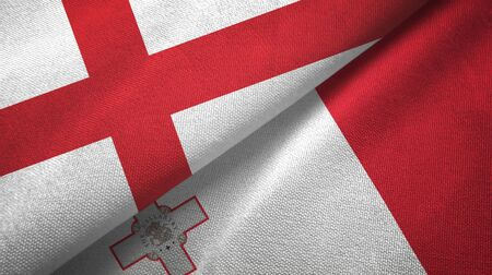 England and Malta flags together textile cloth, fabric texture 스톡 콘텐츠