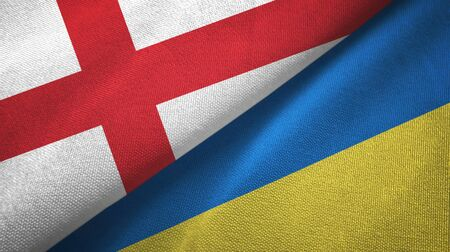 England and Ukraine flags together textile cloth, fabric texture