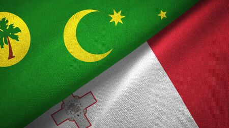 Cocos Keeling Islands and Malta flags together textile cloth, fabric texture 스톡 콘텐츠