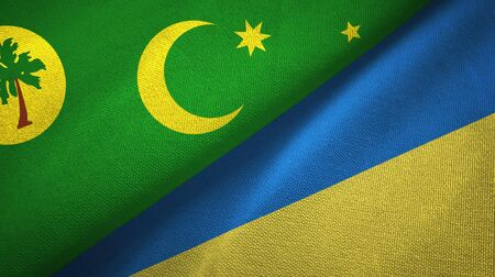 Cocos Keeling Islands and Ukraine flags together textile cloth, fabric texture