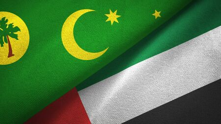 Cocos Keeling Islands and United Arab Emirates flags together textile cloth, fabric texture Banco de Imagens