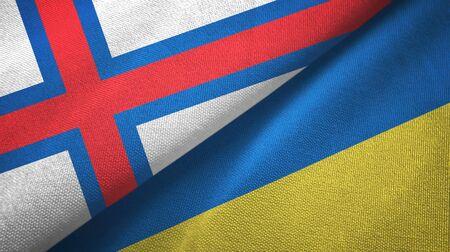 Faroe Islands and Ukraine flags together textile cloth, fabric texture Banco de Imagens