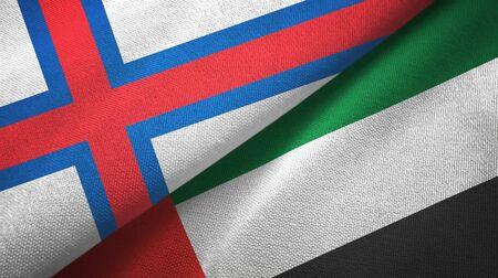 Faroe Islands and United Arab Emirates flags together textile cloth, fabric texture