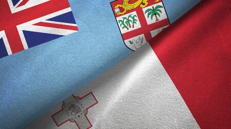 Fiji and Malta flags together textile cloth, fabric texture 스톡 콘텐츠