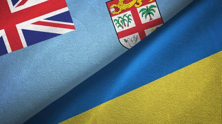 Fiji and Ukraine flags together textile cloth, fabric texture