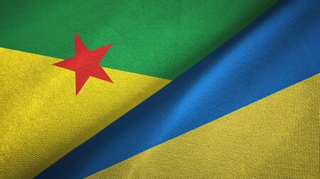 French Guiana and Ukraine flags together textile cloth, fabric texture
