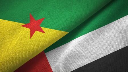 French Guiana and United Arab Emirates flags together textile cloth, fabric texture Banco de Imagens