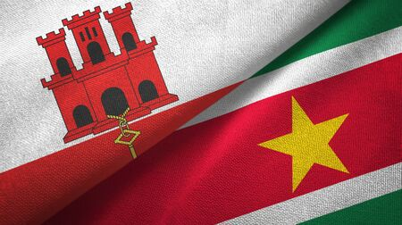 Gibraltar and Suriname two folded flags together