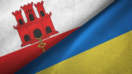 Gibraltar and Ukraine flags together textile cloth, fabric texture