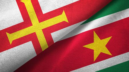 Guernsey and Suriname two folded flags together