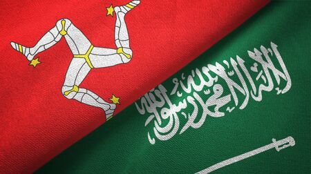 Isle of Mann and Saudi Arabia flags textile cloth, fabric texture. Text on saudi arabian flag means - There is no god but God, Muhammad is the Messenger of God Foto de archivo
