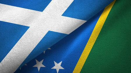 Scotland and Solomon Islands two folded flags together Banque d'images