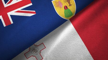 Turks and Caicos Islands and Malta flags together 스톡 콘텐츠