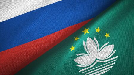 Russia and Macau two folded flags together Stock Photo